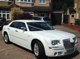 Modern White Chrysler for weddings in Watford